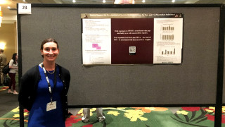 Presenter poses with her scientific poster