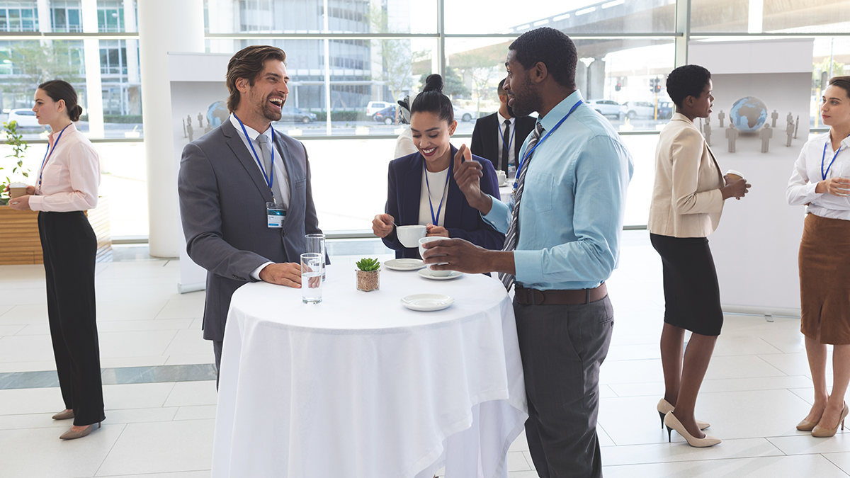 Cheerful colleagues mingle at conference