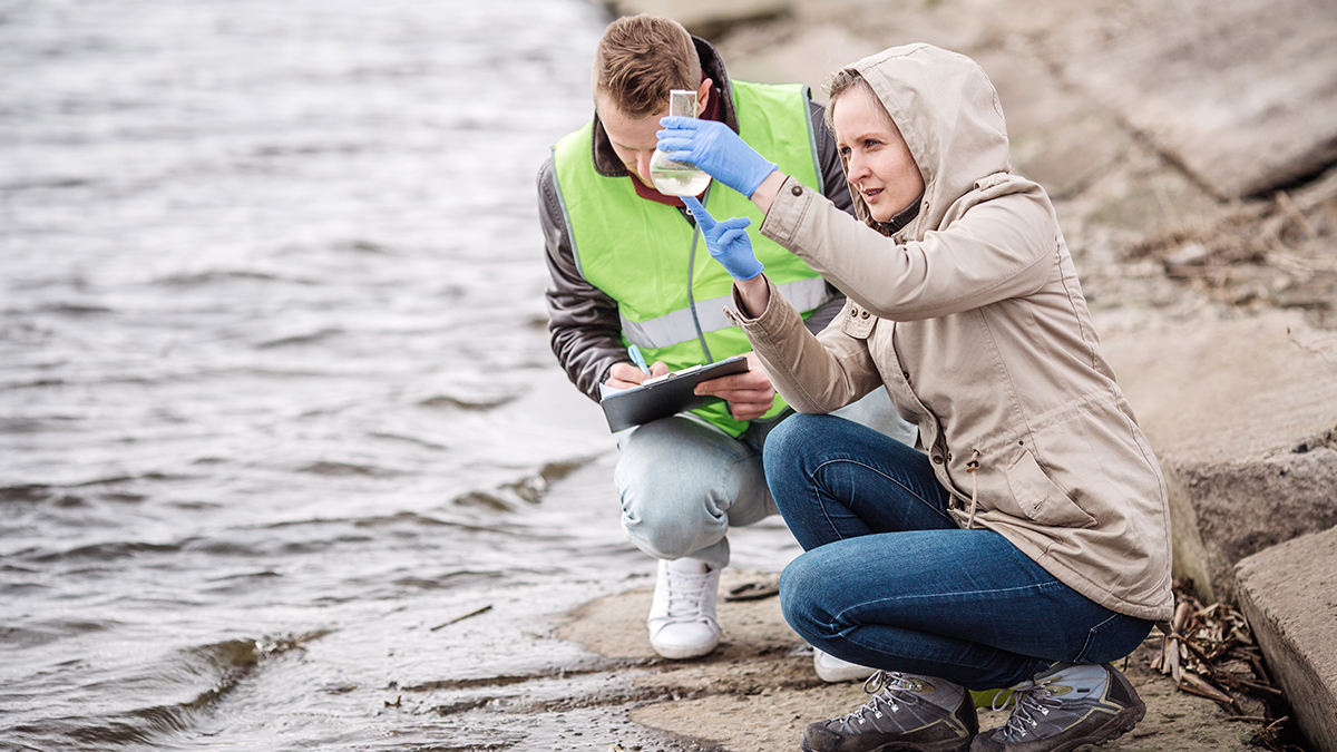 Two scientists testing freshwater