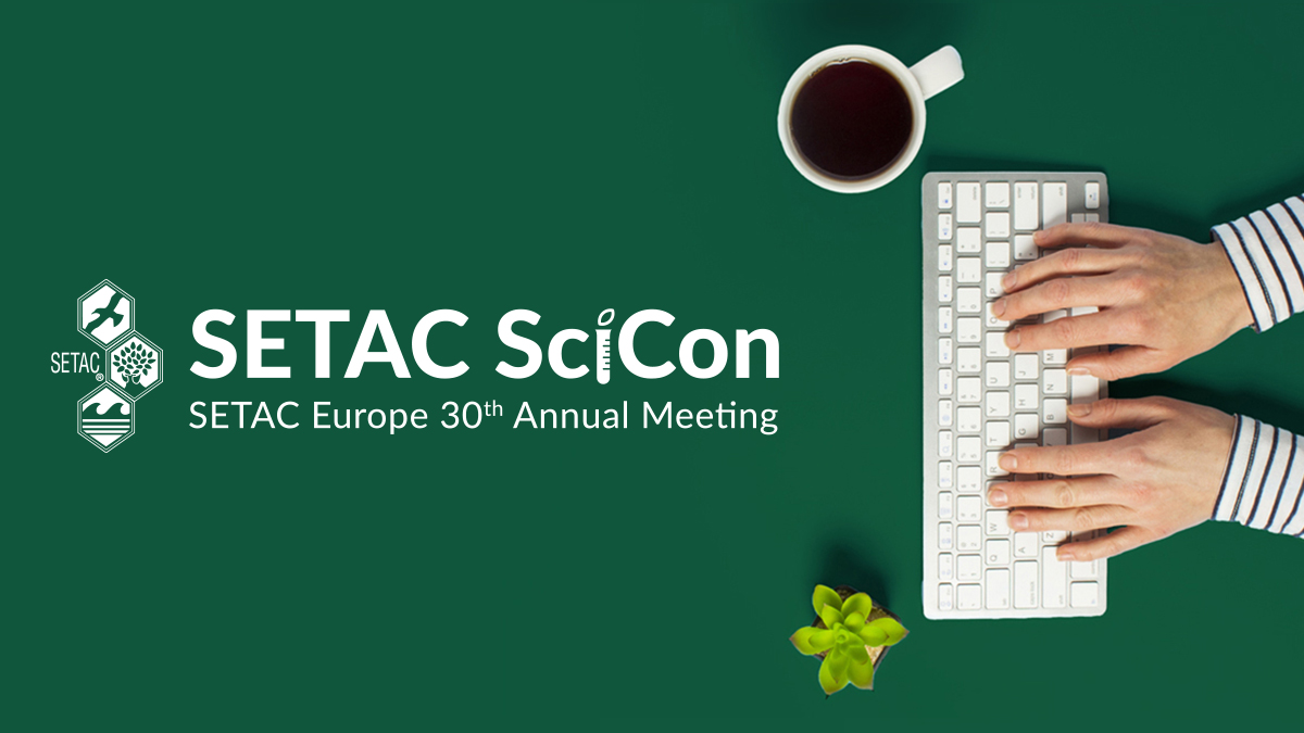SETAC SciCon graphic and keyboard on green background