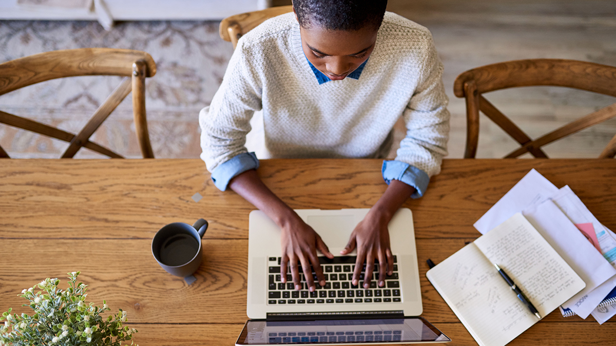 Young African woman focused working from home